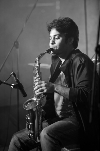 There were some thrilling flourishes on the saxophone, as the guitars and saxophone guided the melodic arrangements of their songs forward.<br/><span class='courtesyName'> Photo Courtesy - Vijay Kate  </span>